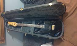 Godin G1000 series excelent condition no schratches comes with case and pedestal play`s better than a strat`s for more information please contact serius byer only