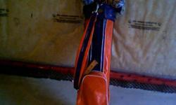 Traditional golf bag for sale including two straps and two head covers. Make an offer. Text 705.255.6585