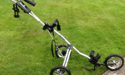 Bag Boy, like new, good quality, 3 wheeled cart. Includes drink and umbrella holder.