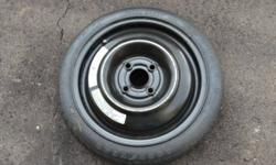 "Good Year Convenience Spare Tire (""Donut"")   BRAND NEW - never used (never left the house)   T105/70D14 84M   T = ""temporary spare"" (""space saver"" or ""mini spare"") 105 = 4.13"" section width 70 = sidewall aspect ratio D = the internal tire body plies"