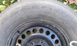 Hi I have just about brand new Goodyear Allegra 215-75/R15 tire mounted on a steel rim. The tire has 9/32 thread left, new tires are about 10/32., This tire still has the blue manufacturing line visible between the threads,  see picture. The steel rim has