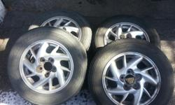Goodyear Allegra Touring All Season tires 205/65/R15 on GM Alloy rims. Very good condition used two seasons alternated with Winter tires. Very good condition $300.00