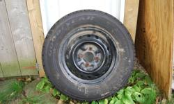 4 Winter Tires and Rims. Nordic Goodyear directional tires. 95% tread left