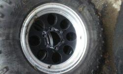 Four rims and three tires,rims are in nice shape,tires are about 60 percent tread,forth tire has some fire damage.Chevy 6 bolt pattern.OBO