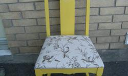 This unique chair has been refinished by hand: was previously in rough shape in appearance, but still good quality.  Made from solid oak and is antique in origin (year unknown).  Lovely, bright yellow with pretty bird seat-cover and filigree detail.