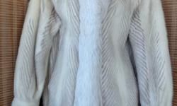Location: OAKVILLE (Bronte Rd area) 905 510-8720 - Original retail cost $4000: This jacket is a few years old, but as it has been stored properly, it has many years left in it. Body is made of alternating strips of mink, light brown & cream (azurene) with