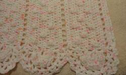 """Gorgeous pink/white/green crocheted baby blanket, made from Bernat Softee Baby Peony Prints yarn.  It is approximately 39""""x59"""" and has beautiful scallops at the top and bottom of it.  This would be a wonderful keepsake blanket!"""