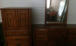 Gorgeous 4 piece solid oak wood set... Wide dresser with mirror, tall dresser and Queen size headboard - Great Quality and condition! Like New!!! 300 or best offer Moving must sell! Asking $300 or Best Offer! Call 705-347-1259