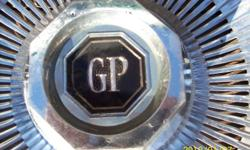 Grand Prix hub caps for sale $65.00 used good condition 14 inch metal hub caps from a 1980 s Grand Prix if you can see this add then the hub caps are still for sale contact today only if you are interested please check out pics i also can ship out to you