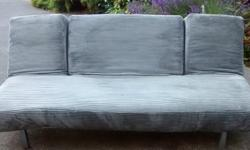 """Chameleon style sofa bed in lovely soft cord fabric. Versatile grey colour. Measures 79"""" length x 41"""" wide x 32.5"""" high. As new condition. From pet free and no smoking home."""