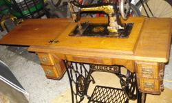 For the Antique lover..Nothing out there even close to this one!!!I have for sale a beautiful high end custom Oak cabinet Antique Singer sewing machine not your average treadle  machine!!!! This machine is in excellent cond for 110+ years!machine turns
