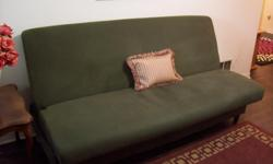 """I have a kaki green futon/sofa bed for sale. Has a metal reclining system. Works fine. The fabric is thick and durable and easy to clean. In great condition. Very comfortable. Asking 175$FIRM Measures 6ft x 54"""" I can deliver as well for small fee."""