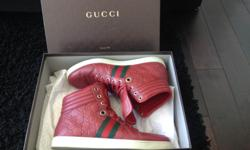 Gucci's Guccissima Leather High Top Sneakers These Gucci shoes were worn and used less than a dozen times. Purchased from the Gucci store itself in Montreal Quebec. It comes with the original box and wrapping paper. Size: 8G (Approximately Size 9 US)