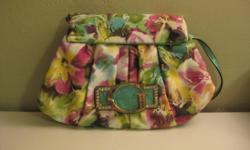 This clutch can either be worn with or without the shoulder strap, it just needs to be tucked into the purse. Can be worn as a purse or carried as a clutch. There are 4 compartments on the inside, one is zippered and the other 3 are pouches. The outside