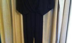 Stretchy black jumpsuit. Only worn once. Cut out in back. Great condition.