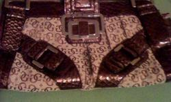 I am selling this gorgeous Guess purse, because I will never use it.   It's been sitting in my closet for almost a year now untouched and I feel bad! At least by selling it someone else can enjoy.   I bought it for about $200 when it came out at the Guess