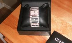 This watch retails for $195 plus tax NOTHING IS WRONG WITH IT! My loss is your steal.  I bought it and have worn it maybe twice...really pretty. Suits girls who like pink and bling! Its original     Great as a gift for xmas $140 firm!