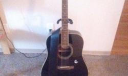 Epiphone guitar, case, stand, strings, and beginner books for sale. Ive played this guitar twice - just due to lack of time and no real desire to learn guitar. It's in mint condition, see the pictures. Please come get it asap. 1st reasonable offer