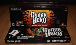 Guitar Hero 1 plus 2 controllers in original packaging. Located in Cobourg
