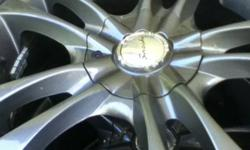 Nice looking rims bought this year that fit pt Cruisers, jetta's, toyota corolla's and cavaliers/ sunfires. They are a Multi pattern 5 bolt rim. They have 205 55 r16 winter tires on them but they have little tread left This ad was posted with the Kijiji