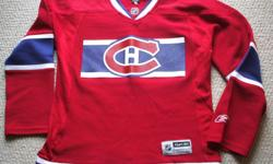 Selling a Habs jersey by Reebok/CCM. Rubberized chest & back logos. Mint condition. Sized ..Youth -Small....$15.