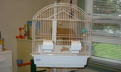 "I have a Hagen cage and stand for sale, excellent condition. 16 1/4"" x 14"" x 19"" high."