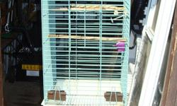 "I have a Hagens bird cage for sale 18""x18""x41""H with stand it is about 56"" H"