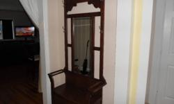 hardwood hall stand it has a large mirror in the center, storage under bench, coat hooks, and place for umbrellas. very solid made of real wood $350 2508844016.