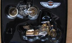 Serial number One,and 2003 Harley Davidson Ultra Classic Electra Glide. Mint condition,new in the box.100TH anniversary edition,hard to find. Gold and Chrome finish.