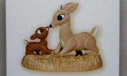 *New* in Box and never displayed on tree. Rudolph &his mother ornament-2007 hallmark magic ornament where Rudolph's nose lights up when button pressed.Batteries included. *Can be seen on ornament websites and ebay for Approx $25 US plus duty,taxand