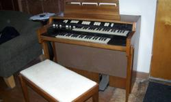 Hammond Organ to give away. Works. But no room or talent to play. Does sound great when the hockey night in Canada theme is played on it. It is a heavy organ.