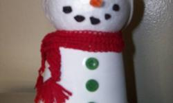 Hand-made snowmen.  Everyone is different...no two the same.  The scarves were hand-crocheted. The hats sewn on my own sewing machine.  Asking $10 each. They can be personalized at no additional cost...so if you would like a name or the year put on them,