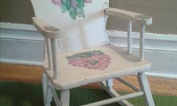 Hand painted child's rocking chair, white with pink and purple blossoms, and a heart on the seat. A beautiful piece.