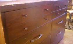 """SOLID WOOD 6 DRAWER DRESSER. ALL DRAWERS WORK JUST FINE /DOVE TALE/. It was painted brown. Can be re-painted - it's solid wood. COMES WITH A MIRROR. Dimensions: 32"""" high, 18"""" deep and 50.5"""" wide CALL ANYTIME: (905) 382-6428 ELIZA Check out my other ads!"""
