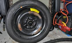 Hankook T105/70D14 83L temporary spare.   We are located about 15 minutes out Lakeshore Dr.   Call 346-8503.