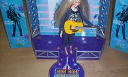 In excellent working condition. Plays music from Hannah Montana songs and stage lights work also. Comes with doll.