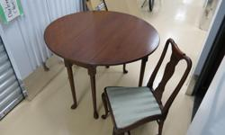 """Lovely Hard-wood drop leaf table and chairs set. Table is """"18 wide, 29"""" high and 43"""" with leaves open. Sturdy pedestal low profile base. Set is perfectly sized for smaller spaces, and students. Asking only $425 for table and 4 hard-wood upholstered (pale"""