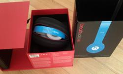 Blue and white accents. Collapsible headphones with black case, box and manuals. Red cord. No scratches. Excellent condition. Soft material very comfortable on the ears. Great quality.