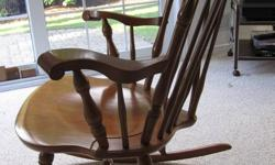 Solid hardwood rocking chair in mint condition.  Asking $50.00 o.b.o.  Please contact Carol at 519-787-0013 if you are interested.
