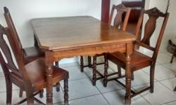 """This is a very nice hardwood table with four chairs. 1950's era. The table is 45"""" x 32"""" and extends to 59"""" with two leaves, 31"""" high. I don't think the chairs are hardwood. The seats are leather covered. The chairs show some sign of wear and tear but"""