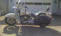 For sale 2007 Harley -  Davisdson Heritage Softtail.  Many extra chrome options have been  added to bike.  15201 miles on bike, and  has always been stored inside.  Sask registered, also included is a brand new rear tire not installed yet. Asking price is