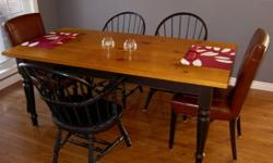 """Custom designed harvest table. Complete with 2 -12"""" company boards which extends the table from 6ft to 8ft. The top is 2"""" thick. Top is stained antique pine and slightly distressed. Legs and skirt are distressed flat black. Modern construction desigh with"""