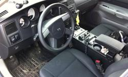 complete console for 2005-2009 charger/magnum police car. comes with all mounting brackets/trim plates. face plates included for equipment. arm rest and cup holders included. this is not a beat up unit-it is clean with a few minor scratches. It has been