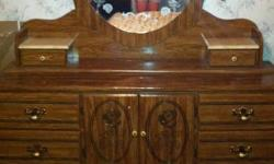 Beautiful two piece set in great condition. Dresser with mirror and matching headboard. Lots of drawer space. 350 obo Please call and leave message. No emails. This ad was posted with the Kijiji Classifieds app.