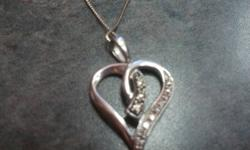 I purchased this necklace its only 4months old and only worn a few times. I purchased it for $400.00 and looking to sell it for $250.00 obo. It is in great condition from charms and will also give the lifetime warranty on the chain. It would make a great