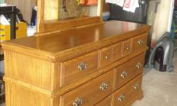 """Made by Palliser, hearthstone oak dresser and mirror in great condition. From s/f, p/f home. Features solid oak fronts with oak veneer tops and durable hardwood. Dresser is 67 in. w. x 19 in. d. x 35 in. high. Mirror is 42"""" w. x 2 in. d x 45 in high."""