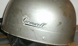 One light blue english cromwell helmet, size medium $ 100.--   One white Shoei 'policestyle' helmet, size medium $ 30.--.