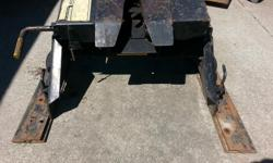 Hijacker Double Pivot 5th Wheel Trailer Hitch. In perfect working condition complete with adjustable mounting rails. Hitch pivots side to side as well as front to back. Hitch can be slid back and forth in mounting rails for proper adjustment. Please check