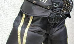"For Sale; Warrior `Hitman` Hockey pants. Jr.sz. Large -26-28""- Great padding and protection. SpineTex rear pad/ `six pack` front pad.Belted with strap buttons Zipper vent inseams. Mint condition-No rips,tears,odours. $20."