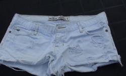 These are Hollister white shorts with rips in them, size 5